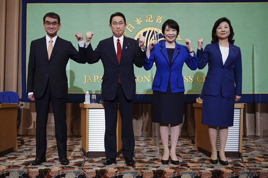 The four candidates in the LDP leadership election pose before a debate.