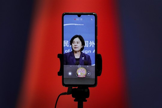 A smartphone records Chinese Foreign Ministry spokeswoman Hua Chunying.