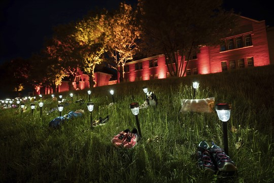 Shoes outside the former Kamloops Indian Residential School honors 215 children whose graves were discovered nearby