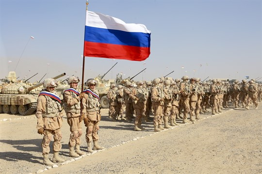Russian troops line up before the start of joint military drills with Tajik and Uzbek forces