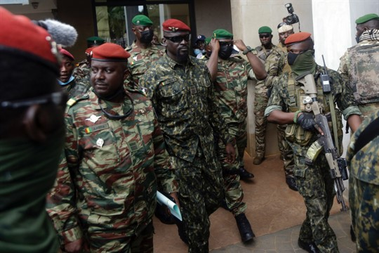 Guinea's Junta President Col. Mamady Doumbouya surrounded by soldiers.