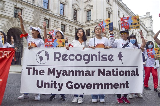 Protesters hold a banner calling on world leaders to recognize Myanmar's National Unity Government, in London