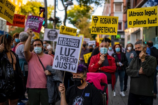 People take part in a protest against high electricity prices in Madrid.